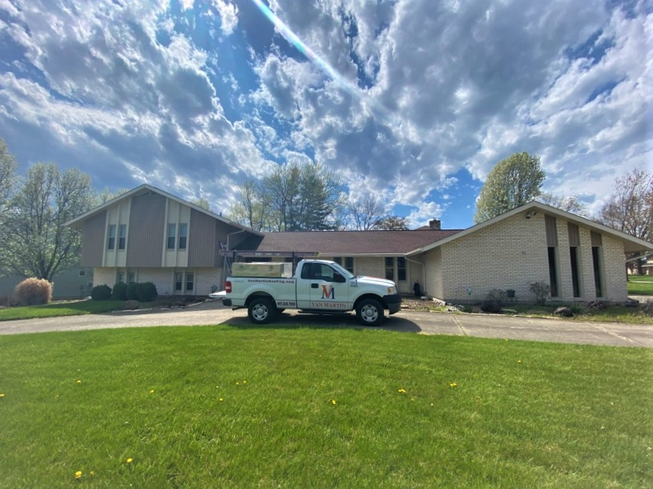 Van Martin Roofing performing a free roof inspection.